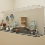 Display featuring Guanxiu period Pair of Famille Rose Celadon Vases